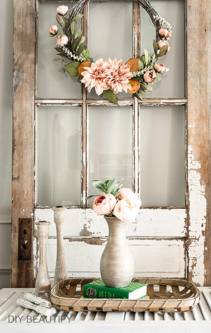 vintage chippy door with Restoration Hardware vase and candlesticks