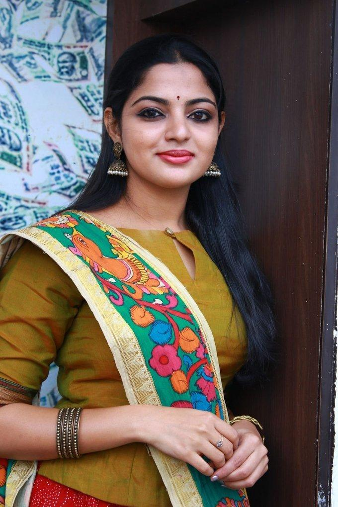 Indian Actress Nikhila Vimal Hot Stills In Yellow Dress