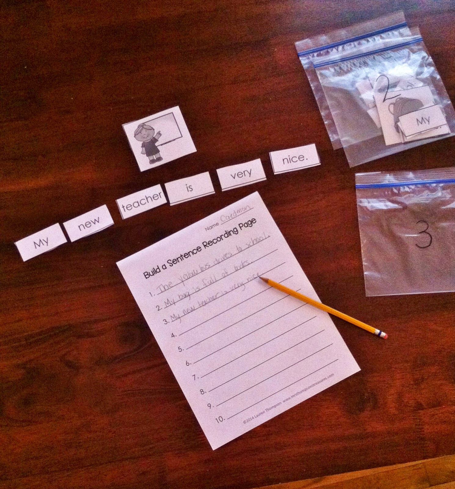 http://www.teacherspayteachers.com/Product/Back-to-School-Build-a-Sentence-Literacy-Center-Activity-1294000