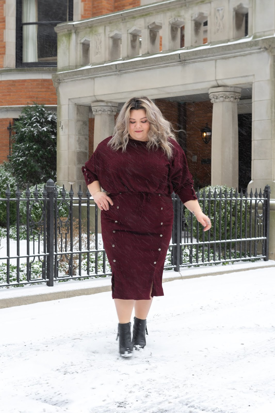 Chicago Plus Size Petite Fashion Blogger, youtuber, and model Natalie Craig, of Natalie in the City, reviews Soncy's Ruby Red Midi Skirt and Cropped Top.