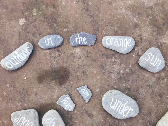 Word pebbles spread out on the ground