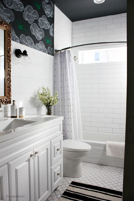 white subway tiled bathroom with black ceiling