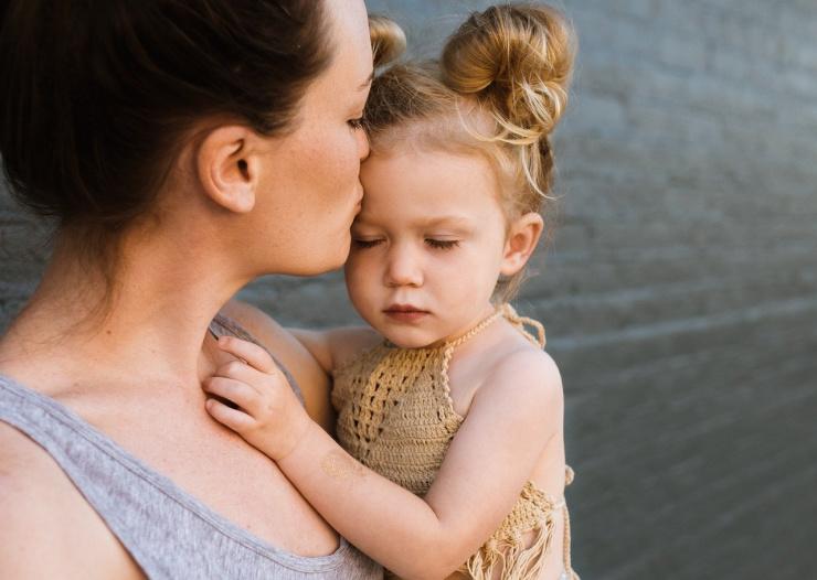 child and mum hug