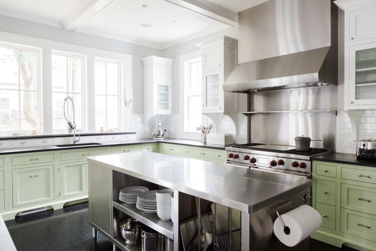 Modern farmhouse kitchen with stainless island on Hello Lovely Studio