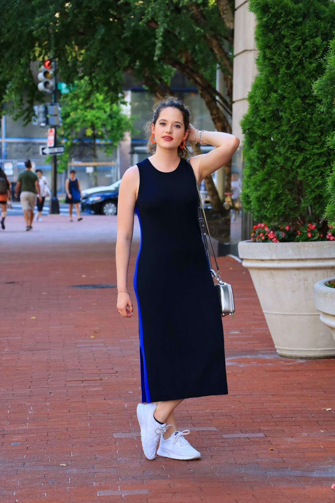 Nyc fashion blogger Kathleen Harper wearing a midi dress and sneakers outfit.