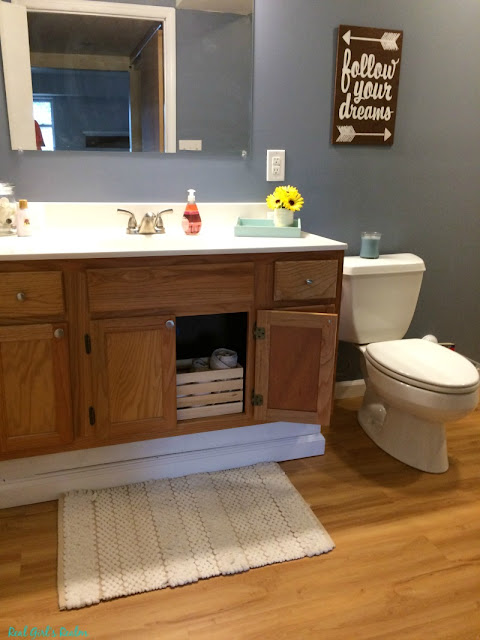I am finally revealing our basement guest bathroom and how I decorated it on a shoestring budget!