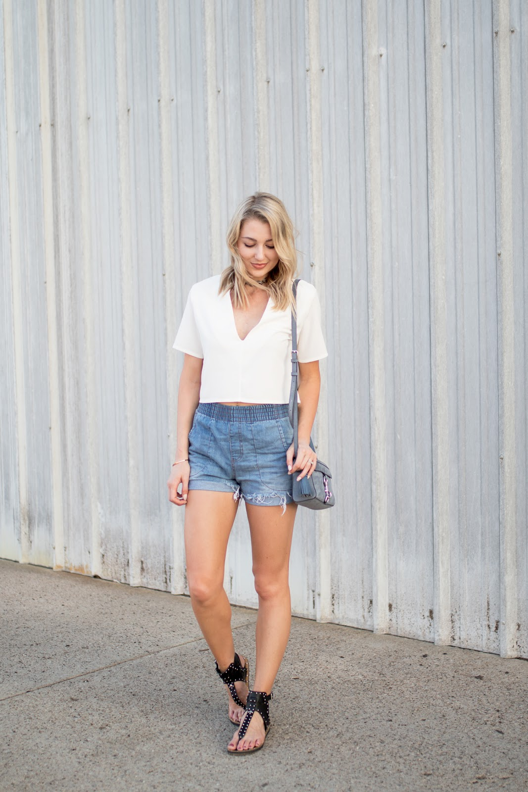 Structured top with casual shorts