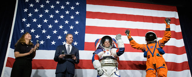 NASA spacesuit engineer Amy Ross and NASA Administrator Jim Bridenstine introduce spacesuit engineer Kristine Davis, wearing a ground prototype of NASA's new Exploration Extravehicular Mobility Unit (xEMU), and Orion Crew Survival Systems Project Manager Dustin Gohmert, wearing the Orion Crew Survival System suit