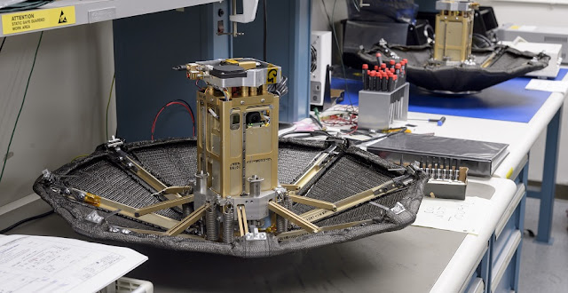 Twin ADEPT units include a flight unit for the first flight test on Sept. 12 and a spare. The units are shown fully deployed. The heat shields measure 28 inches in diameter. This test configuration includes a payload that is sized to approximate a 3U, or three unit, CubeSat, about 12 by 4 by 4 inches. This design could be adapted to build larger heat shields to support larger payloads. Credits: Credits: NASA Ames Research Center/Dominic Hart