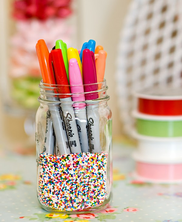 Using sprinkles as jar decorations storing sharpies!