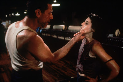A sweaty, brutish Warwick (Stephen Macht) forcefully grabs Jane's (Kelly Wolf) chin in a movie scene for the horror film Stephen King's Graveyard Shift