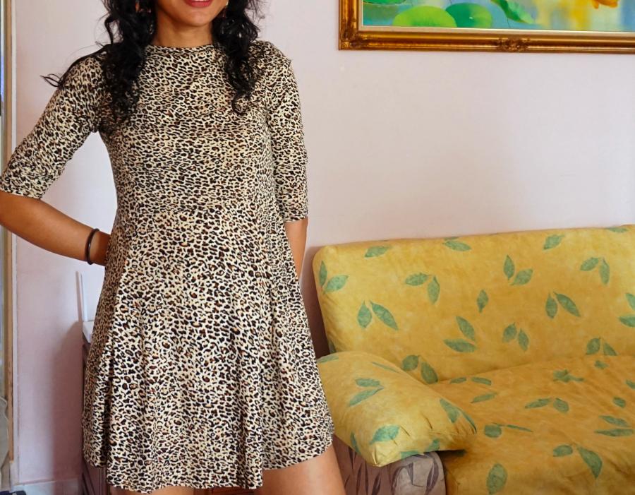 Standing in my leopard print dress