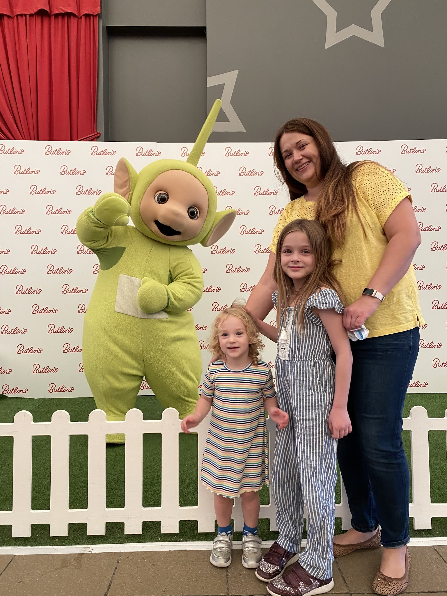 green teletubby with family