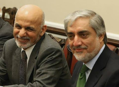 Afghan President Ghani and rival Abdullah sign power-sharing deal