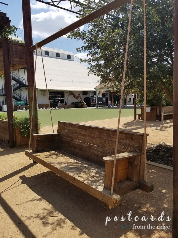rustic reclaimed wooden swing with ropes