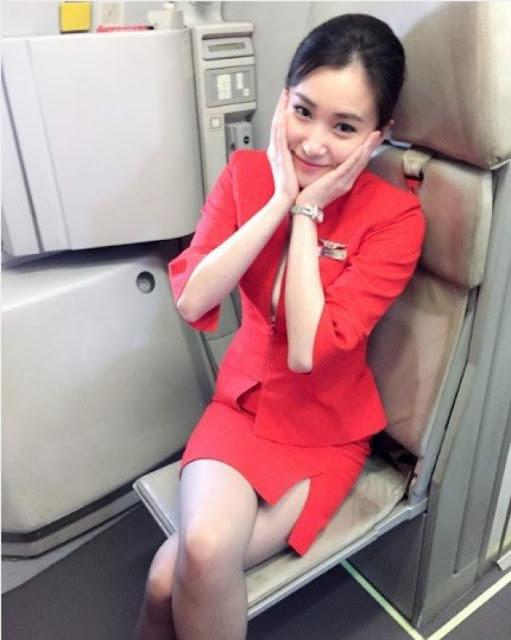 Pretty Asian Women: Malaysian AirAsia Flight Attendant | 511 x 640 jpeg 59kB