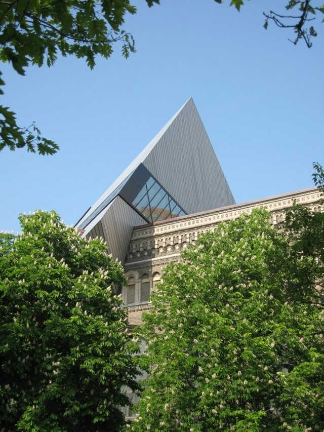 Royal Ontario Museum by Studio Daniel Libeskind as seen through trees and vegetation