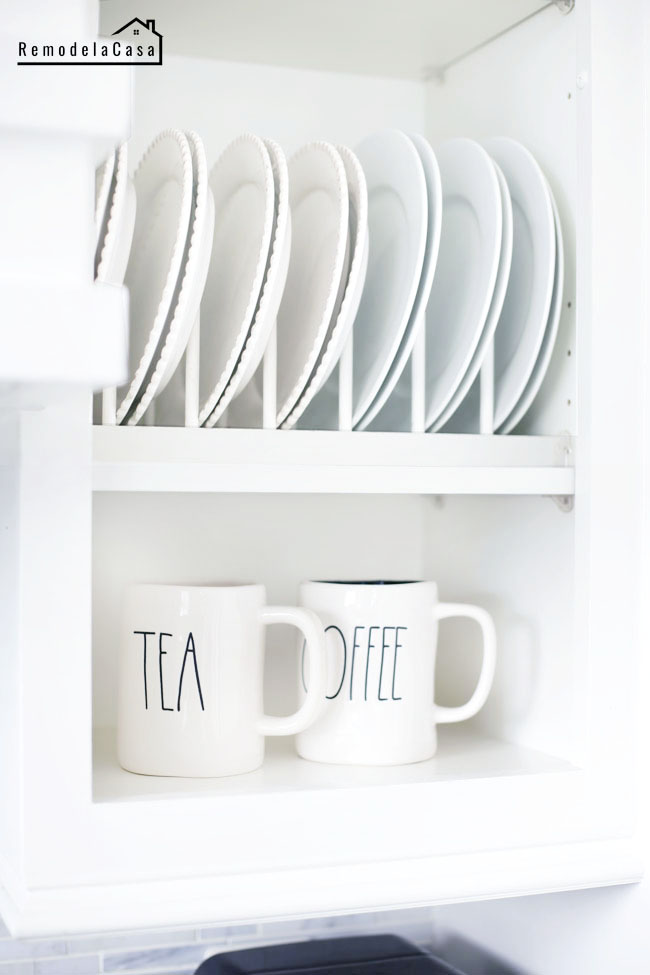 kitchen organization - cupboards with plates and tea and coffee cups