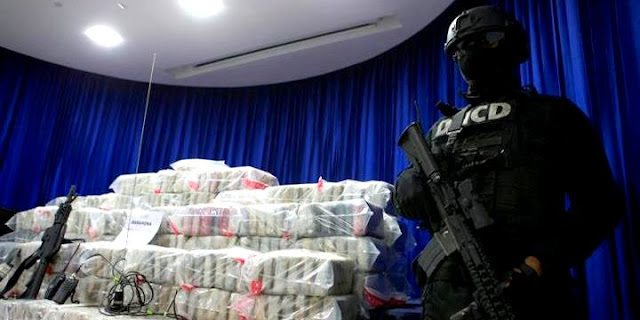 Image Attribute: Members of the National Directorate for the Control of Drugs (DNCD), exhibit a shipment of more than one ton of drugs confiscated in Santo Domingo, Dominican Republic, on Dec. 14, 2017. EPA-EFE/Orlando Barria