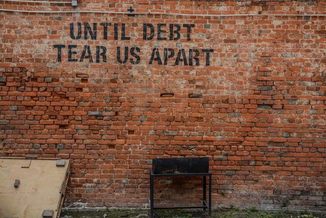 Debt written on the brick wall