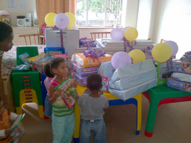 Children from the Zanethemba Children's Haven with donations from Hollywoodbets Parliament Street (Port Elizabeth)