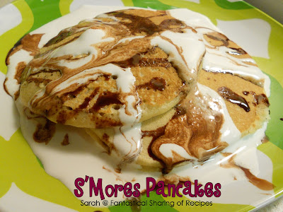 S'mores Pancakes | Homemade graham cracker pancakes topped with a homemade chocolate syrup and a little storebought marshmallow creme = heaven in your mouth! #breakfast #smores #chocolate #marshmallow #pancakes