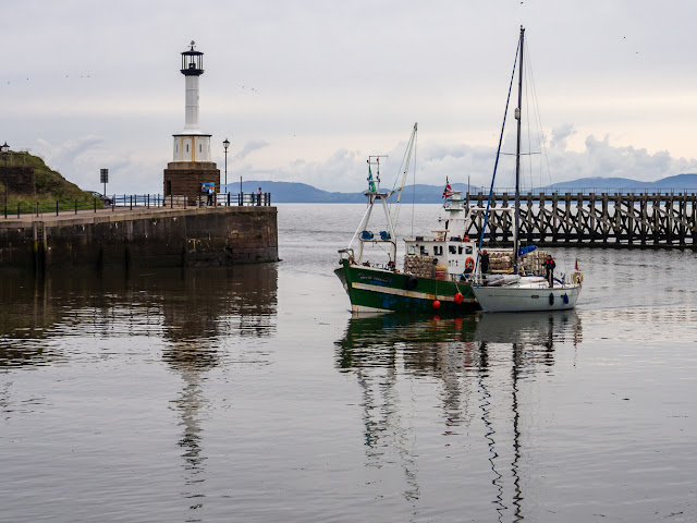 Photo of fishing boat Silver Stream towing a yacht back to Maryport Marina