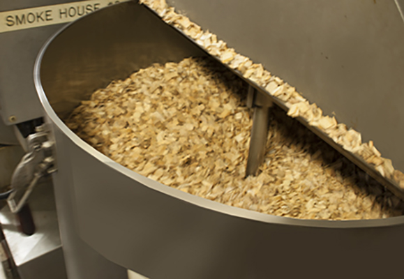Hickory wood chips in smoker at Fresh Mark Company, Massillon, OHIO