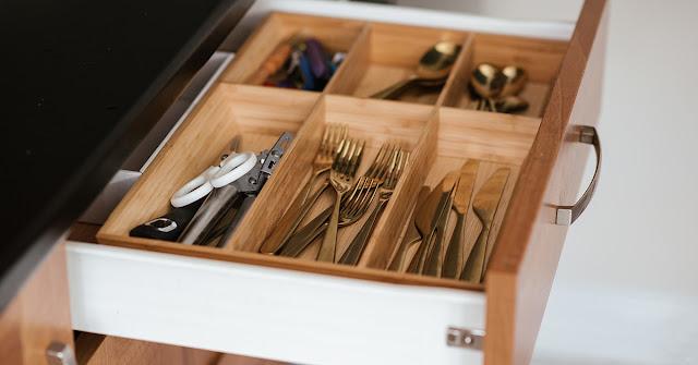 Utensil drawer organizer in the kitchen drawer.