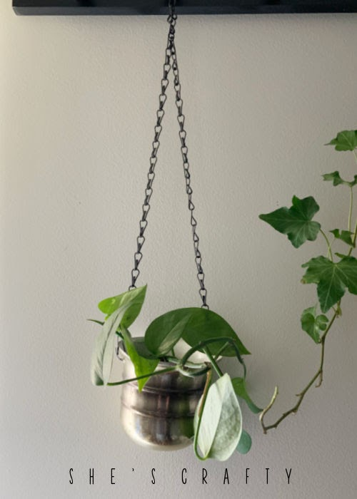 Plant hanger made from vintage metal cup.