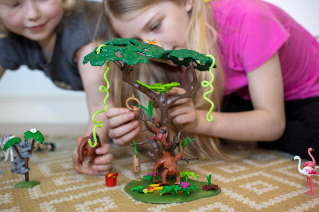 girls playing with plastic Playmobil Orangutan toys as part of review