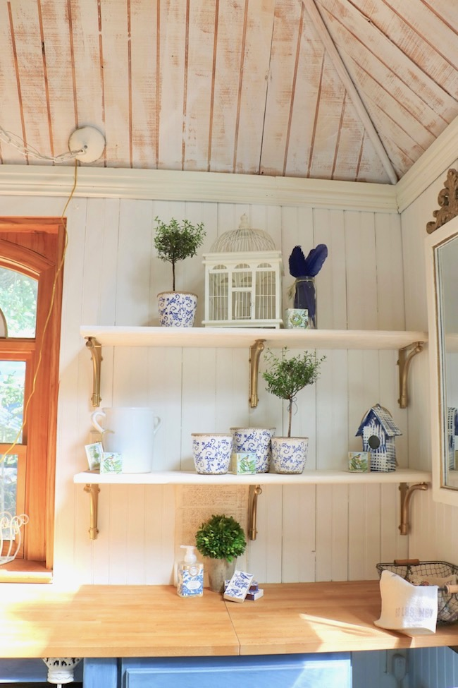 Garden shed DIY open shelves cost $100, but look much more expensive