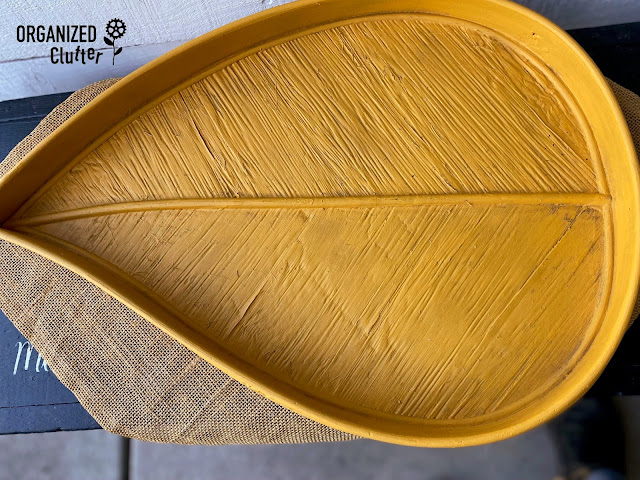 Photo of a mustard painted wood tray with antiquing.
