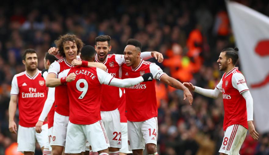 The Gunners celebrate Lacazette's winner against West Ham