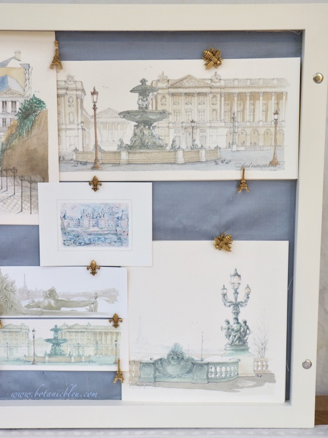 Another layout technique for arranging prints in a shadowbox is to layer the prints