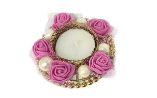Pink coloured roses and and beads designed candles