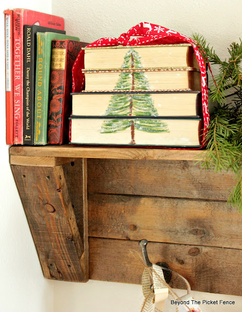 paint a tree on thrift store books and make paper chains to decorate for Christmas