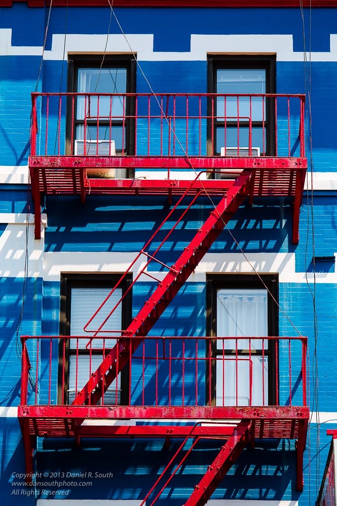 a photo of a red fire escape in new york city