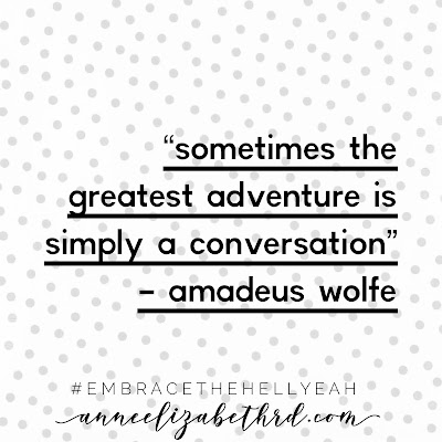 "Inspiration quote in black letters with a white background with grey polka dots saying ""sometimes the greatest adventure is simply a conversation"" by Amadeus Wolfe"