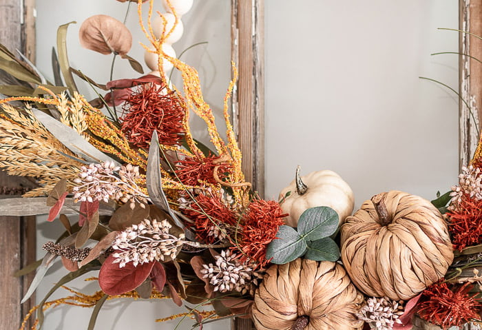 Fall wreath with natural pumpkins and foliage