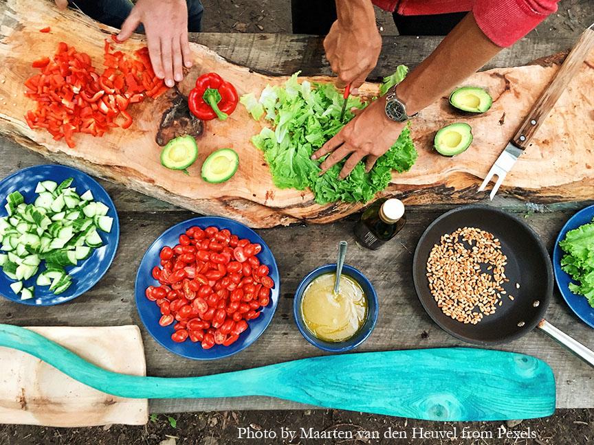 People slicing vegetables