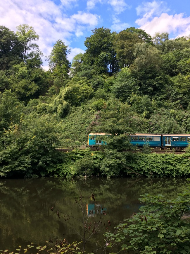 Our-weekly-journal-7-august-2017-trains-and-bikes-toddler-on-bike-train-across-river-taff
