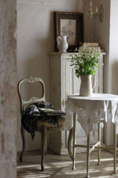 Gorgeous French farmhouse timeless and tranquil vignette with antique chair and cabinet