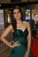 Raashi Khanna in Dark Green Sleeveless Strapless Deep neck Gown at 64th Jio Filmfare Awards South ~  Exclusive 063.JPG