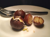 Serving garnished kala jamun for kala jamun recipe