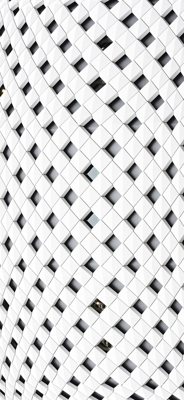 خلفية واجهة نقوش هندسية بيضاء بأشكال معينة