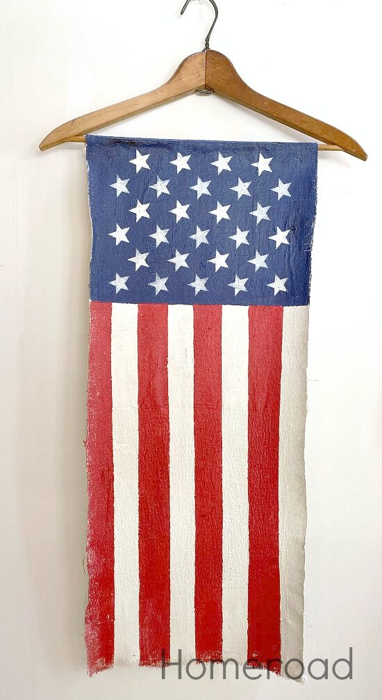 Red white and blue vertical American flag on hanger