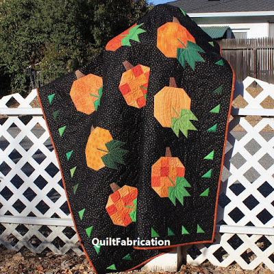 Pumpkin Harvest lap quilt by QuiltFabrication