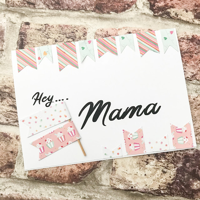 Handmade card with Hey Mama text across the centre and flag style edging and flags on the front