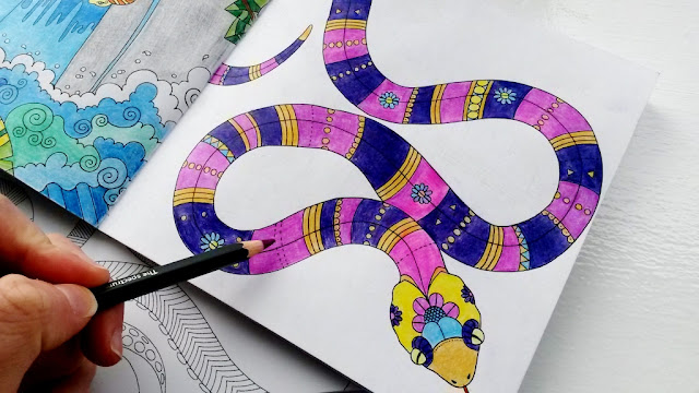 Colouring in snake with purple pencil